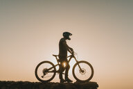 Spain, Lanzarote, mountainbiker on a trip at sunset - AHSF00099
