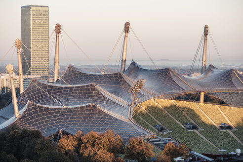 Germany, Munich, Olympic Park, Olympic Stadium, tent roof construction in the morning light - WFF00041