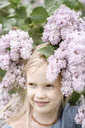 Portrait of smiling girl with lilac blossoms - EYAF00007