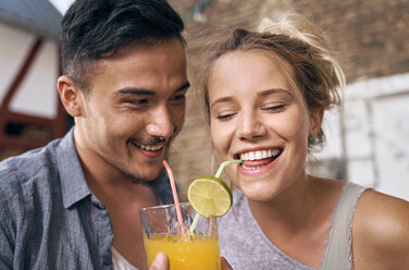 Young couple drinking cool lemonade in a backyard - PDF01863