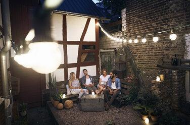 Friends sitting in the backyard, talking - PDF01878