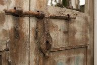 Old Iron Door Latch on Wooden Door - MINF10913