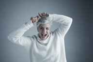 Portrait playful enthusiastic Caucasian senior woman with short white hair laughing - HEROF30077