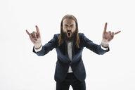 Exuberant businessman with beard gesturing rock n - HEROF30106