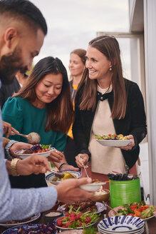 Friends enjoying buffet on terrace - MASF11578