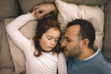 Directly above shot of father and daughter sleeping on couch at home - MASF11599