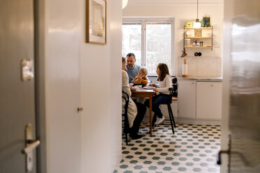 Family having meal together in kitchen at home - MASF11608