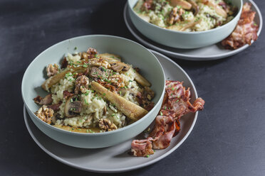 Mushroom risotto with caramelized pear and walnuts in bowl, bacon on plate - STBF00260