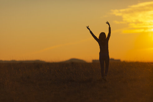 Woman walking in nature at sunset - JPF00367