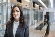 Portrait confident female attorney in courthouse corridor - HEROF30292