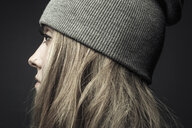 Profile portrait thoughtful beautiful woman with nose ring in beanie - HEROF30343