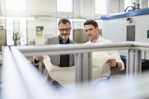 Two businessmen discussing plan in a factory - DIGF06228