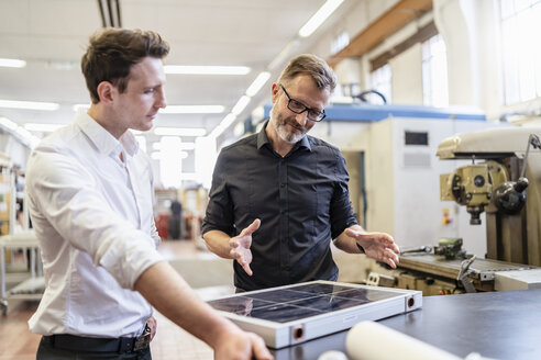 Two colleagues in factory working on solar cell - DIGF06237