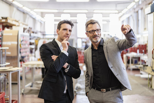 Two businessmen talking in a factory - DIGF06264
