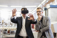 Two businessmen with VR glasses in factory - DIGF06270