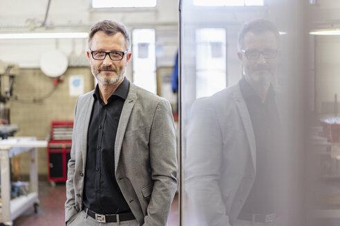 Portrait of confident businessman in factory - DIGF06279