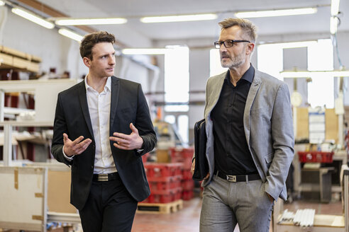 Two businessmen talking in a factory - DIGF06285