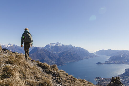 Italy, Como, woman on a hiking trip in the mountains above Lake Como - MRAF00387