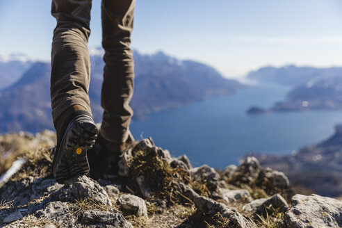 Italy, Como, detail of hiking boots on the rock - MRAF00396