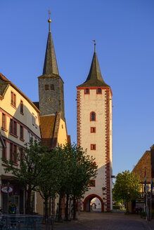 Germany, Bavaria, Franconia, Lower Franconia, Karlstadt am Main, hospital church and gate tower in sunset - LBF02471