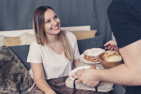 Young man serving breakfast in bed for girlfriend - SEBF00074