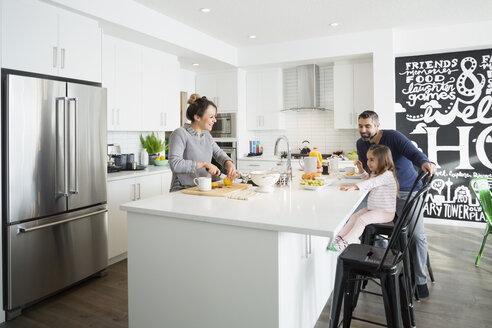 Family enjoying breakfast in morning kitchen - HEROF30413