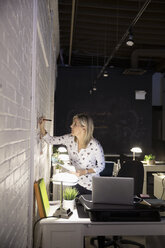 Creative businesswoman working late brainstorming in office - HEROF30494