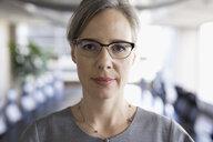 Close up portrait serious, confident businesswoman wearing eyeglasses - HEROF30581
