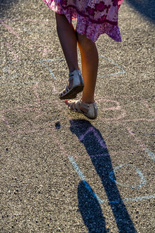 Girl playing hopscotch, partial view - SARF04171