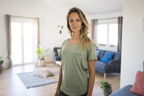 Portrait of smiling woman at home - SBOF01906
