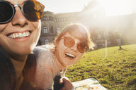 Portrait of two women laughing in park - GCF00247