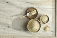 Organic amaranth in bast bowls, on wood, from above - ASF06330
