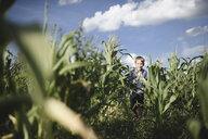 Happy boy running in a cornfield - EYAF00035