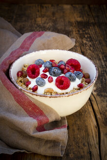 Bowl of muesli with Greek yogurt, popped quinoa, raspberries, blueberries and pomegranate seeds, from above - LVF07907
