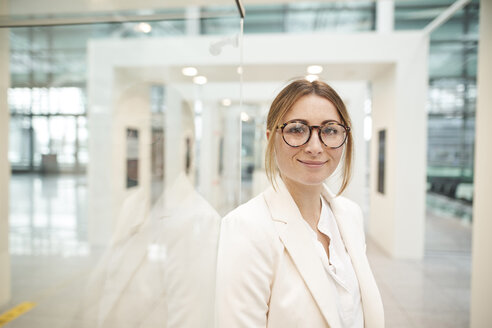 Portrait of confident young businesswoman wearing glasses - PNEF01373