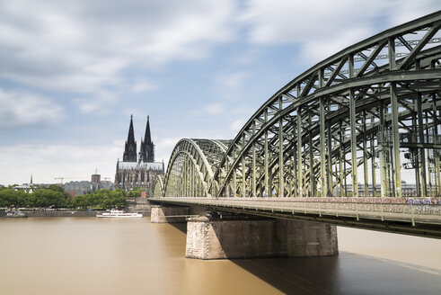 Germany, Cologne, view to Cologne Cathedral with Hohenzollern Bridge and River Rhine in the foreground - MKFF00471