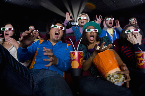 Movie audience in 3D glasses, making faces, low angle view - JUIF00256