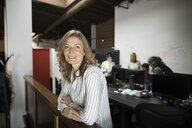 Portrait confident businesswoman in open plan office - HEROF31201