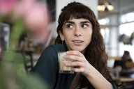 Portrait of young woman in a cafe looking around - FLLF00075