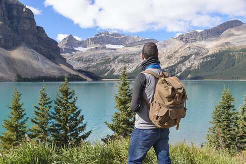 Canada, Jasper and Banff National Park, Icefields Parkway, man at lakeside - EPF00576