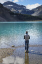 Canada, Jasper and Banff National Park, Icefields Parkway, man at lakeside - EPF00579