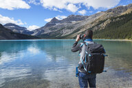 Canada, Jasper and Banff National Park, Icefields Parkway, man at lakeside - EPF00582