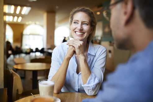 Portrait of happy woman with man in a cafe - PNEF01402