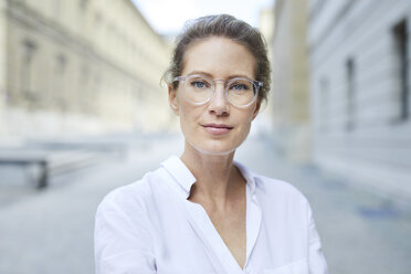 Portrait of confident woman wearing glasses and white shirt in the city - PNEF01456