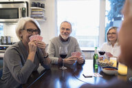 Senior couple friends playing poker and drinking beer - HEROF31566