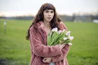 Young woman with bouquet of tulips and pink coat - FLLF00078