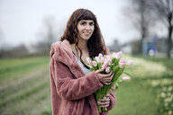 Young woman with bouquet of tulips and pink coat - FLLF00081