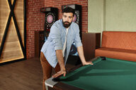 Portrait of man at billiard table - ZEDF02013