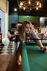 Young woman playing billiards - ZEDF02022