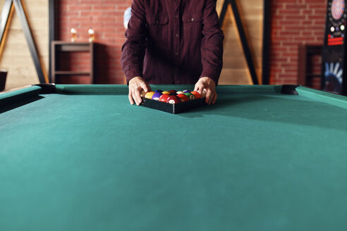 Close-up of billiards player arranging balls on table - ZEDF02031